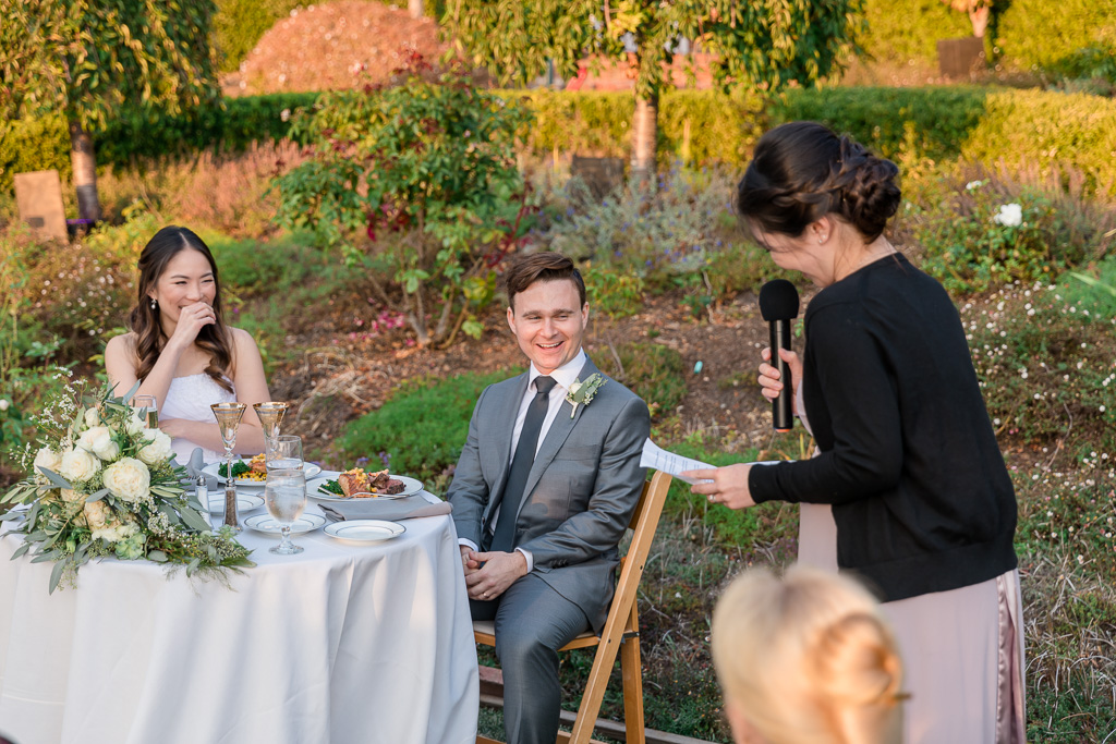 bridesmaid giving funny toast to bride and groom