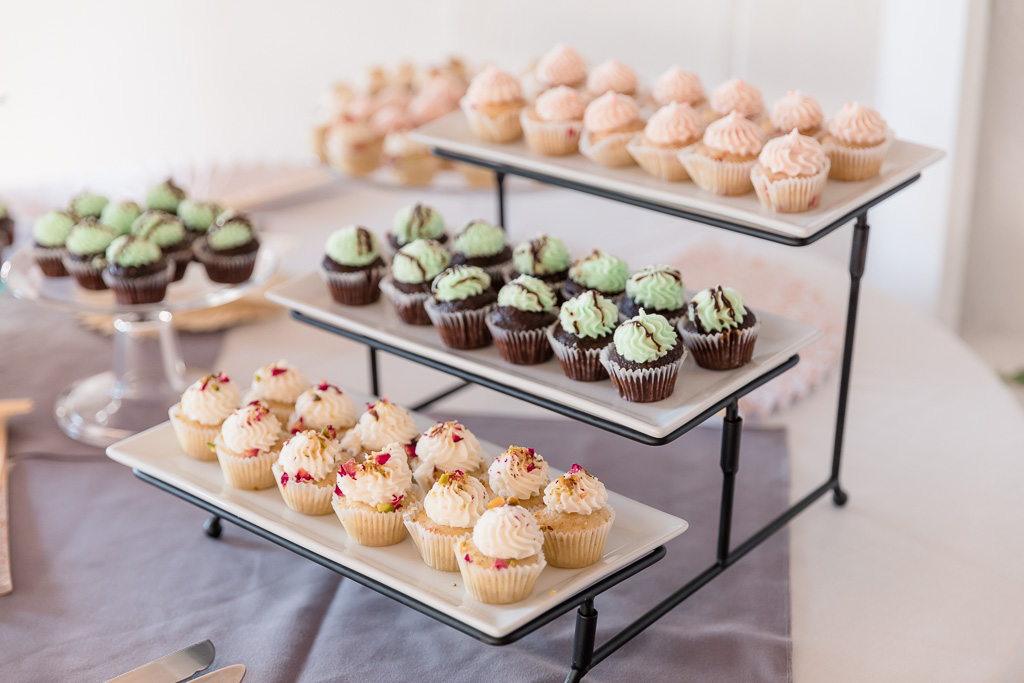 wedding cupcakes displayed on a cute stand