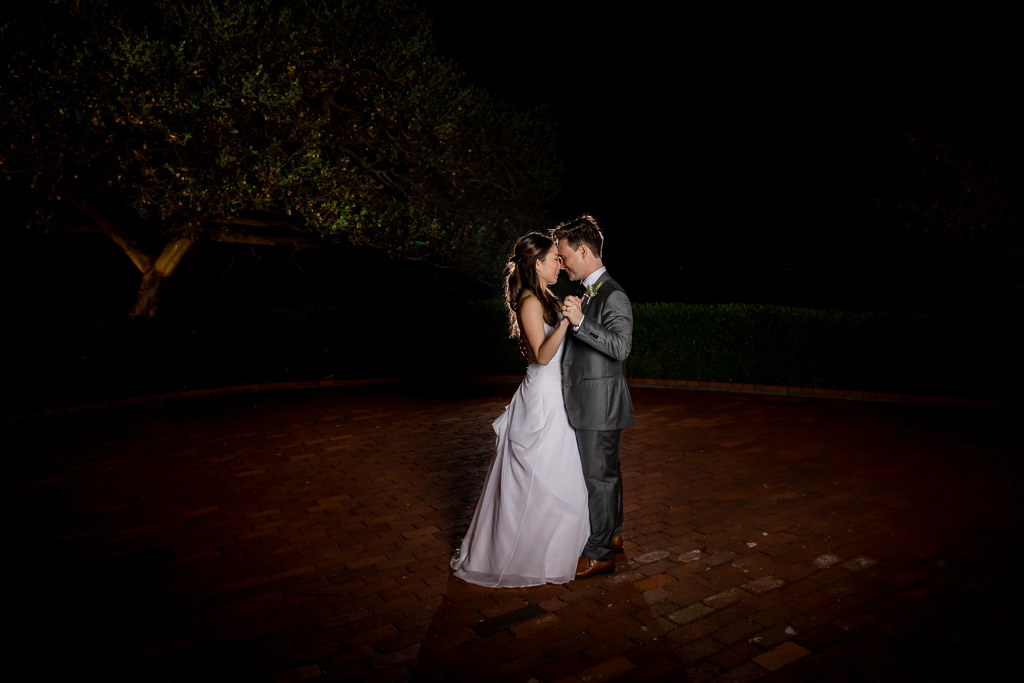 dramatic lighting for bride and groom last dance