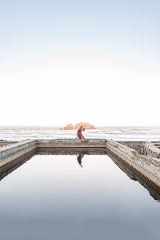 epic Sutro Baths sunset engagement photo dip in dress