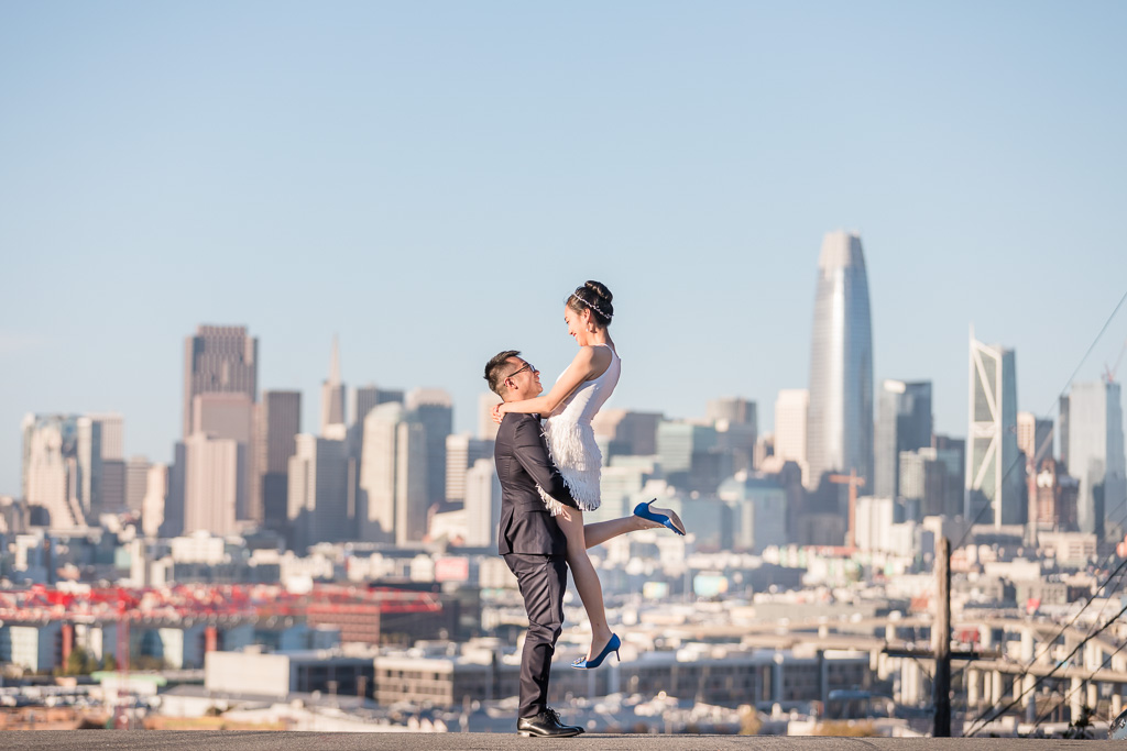 wedding photo lift up in front of San Francisco city skyline
