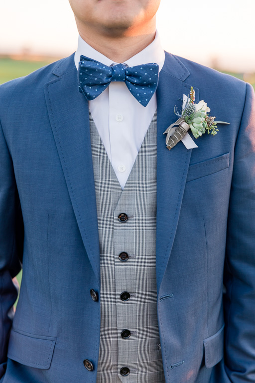 groom vest and jacket with boutonnière and bow tie