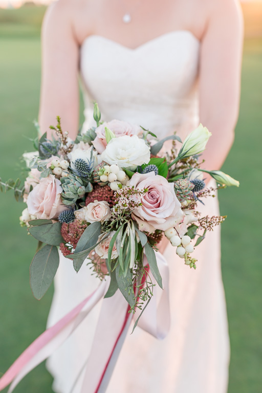 bride holding wedding floral bouquet