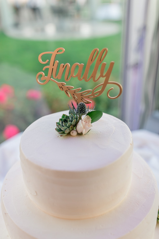 wedding cake with the word Finally