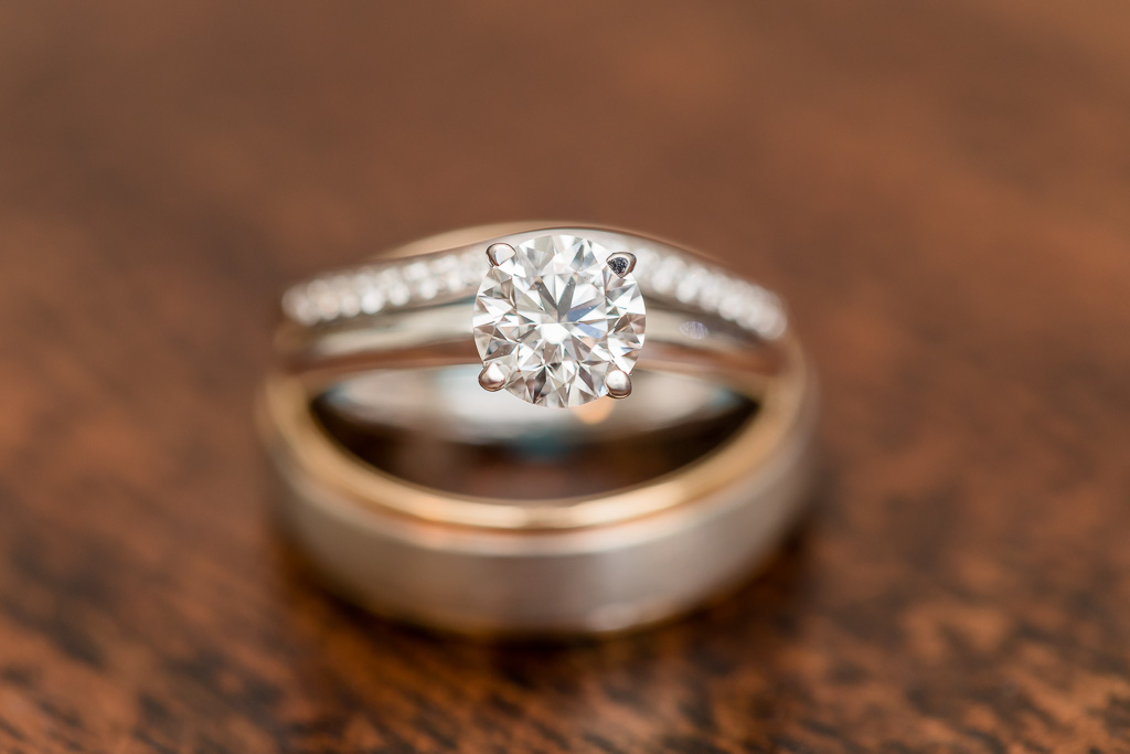 close-up of wedding and engagement rings