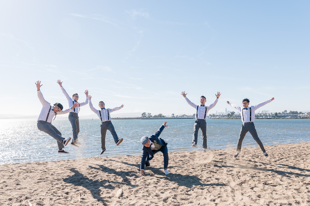 groom and groomsmen power slam funny photo at the beach