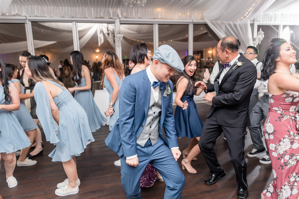 groom showing off some moves on the dance floor