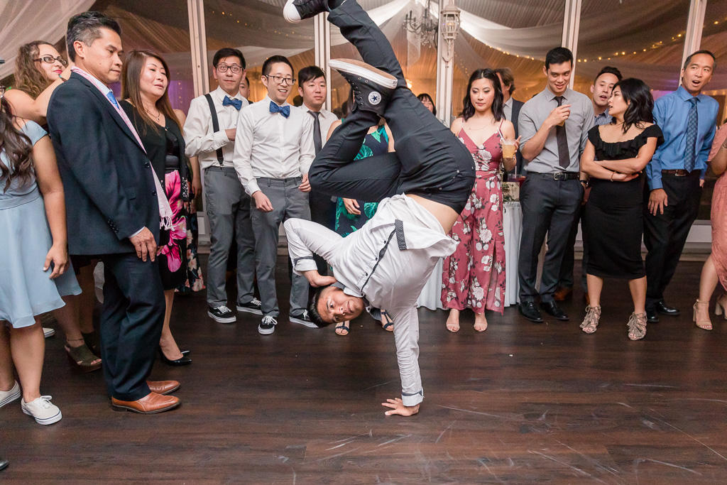 great break dancing handstand on wedding dance floor