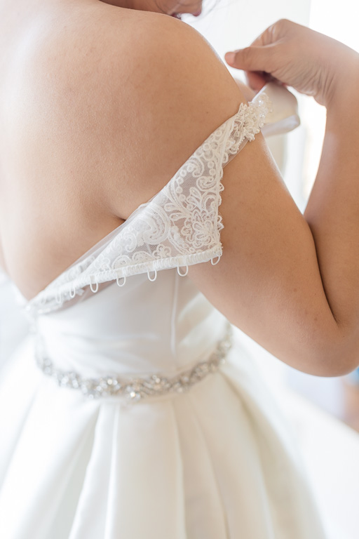 delicate details of the wedding gown