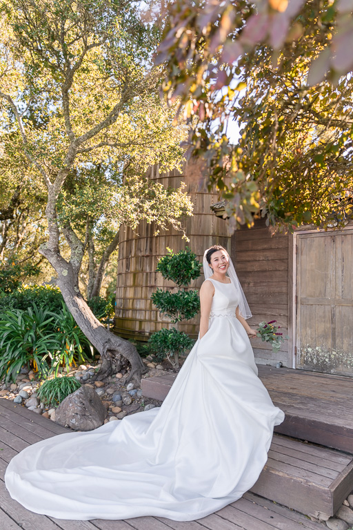 Thomas Fogarty Winery bride solo portrait with her dramatic wedding gown