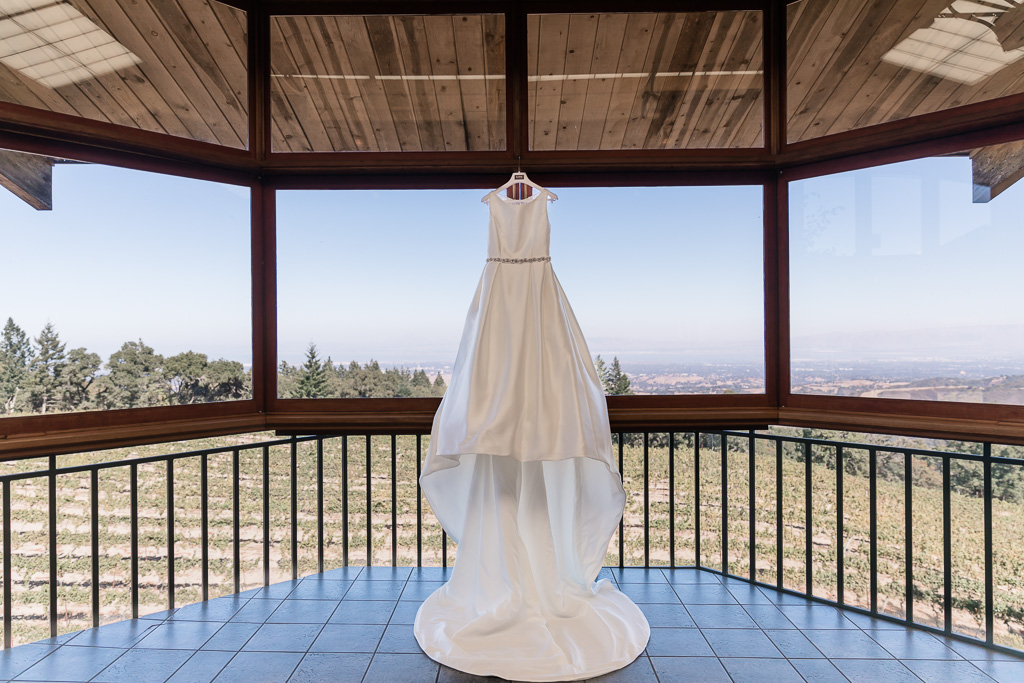 elegant wedding gown hanging on the window of Thomas Fogarty Winery