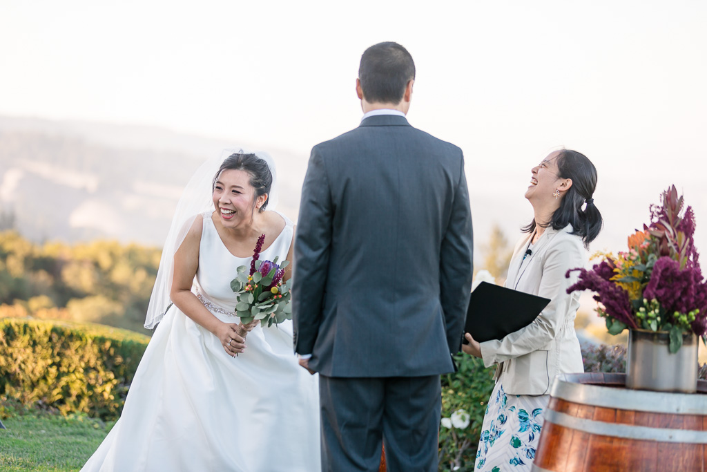 bride laughing hard during the ceremony