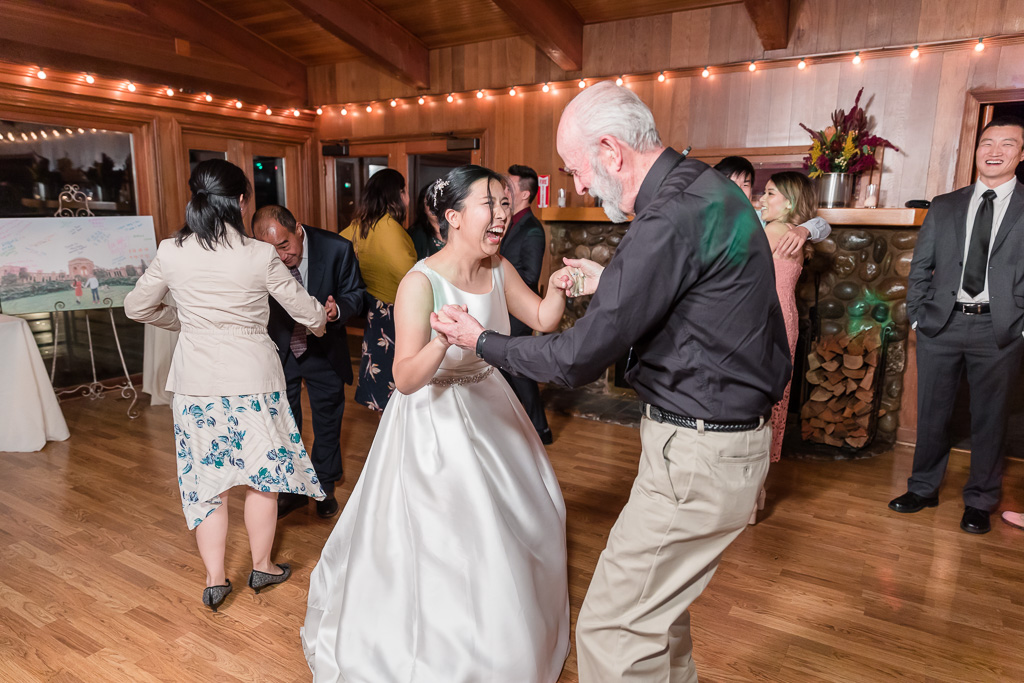 bride dancing happily with her guests