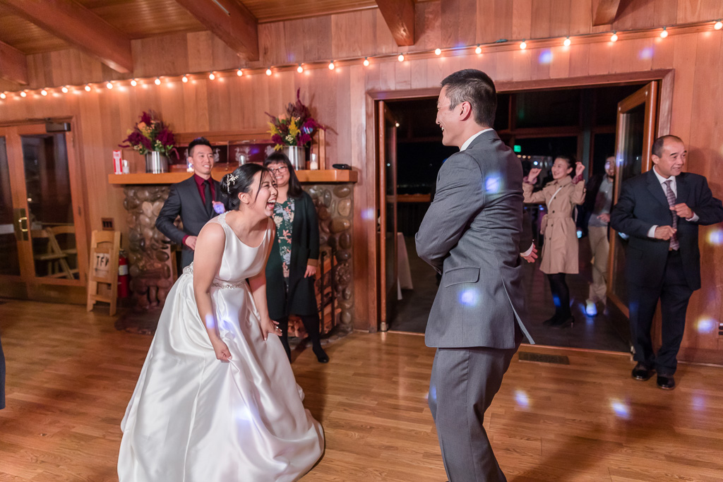 bride laughing hard at groom's goofy dance moves