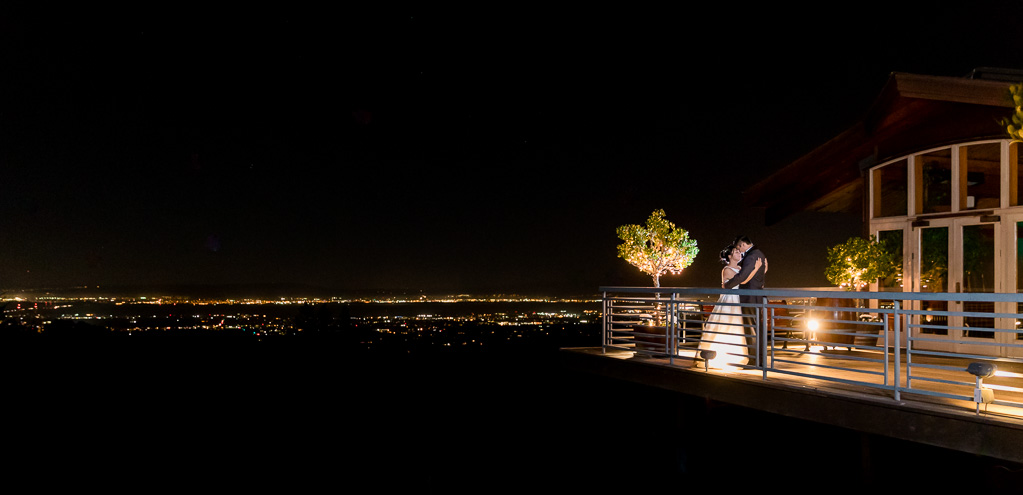 night photo of bride and groom at Thomas Fogarty Winery and Vineyards