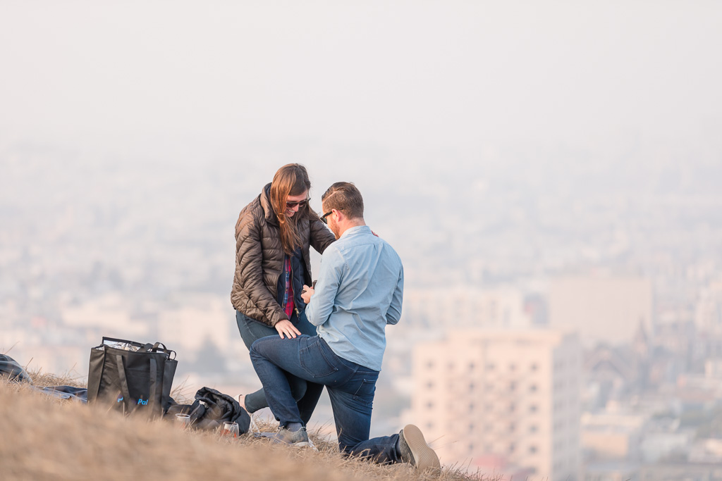 he proposed to her with a beautiful engagement diamond ring in San Francisco