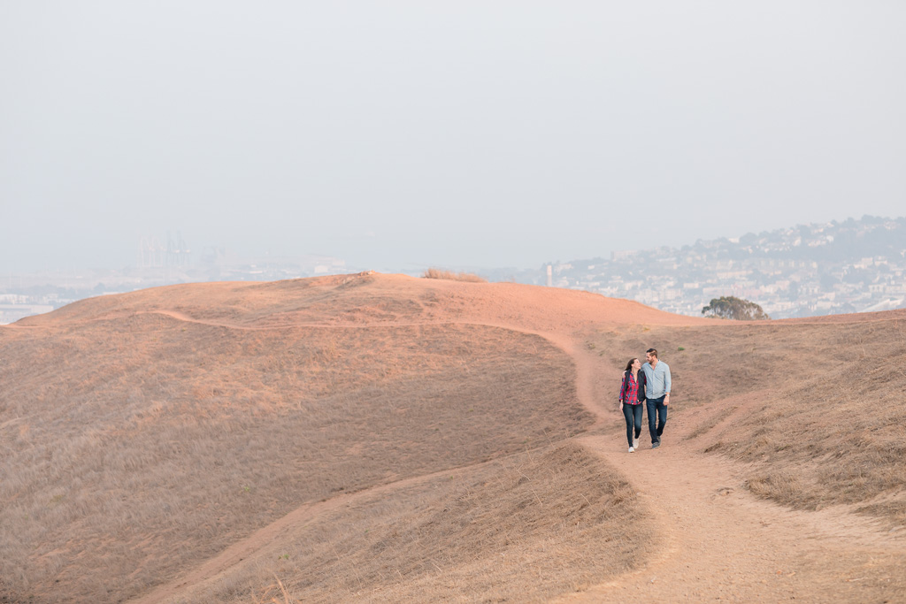 newly engaged couple casually walking at Bernal Heights