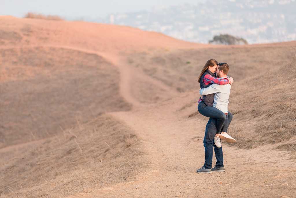 engagement photo on the rolling hills at Bernal Heights