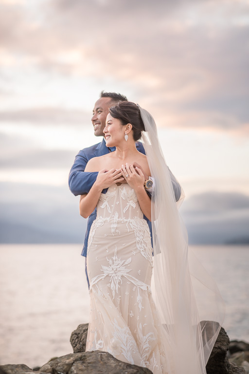 wedding photo with a dramatic colorful sky over the ocean