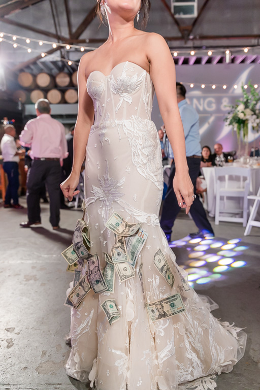 bride with dress full of cash after money dance