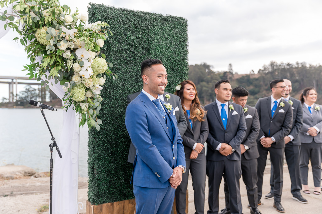 groom anxiously awaiting bride during wedding ceremony
