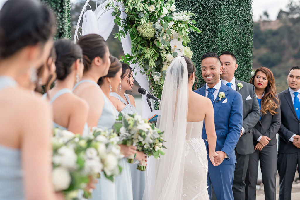groom looking at his bride during wedding ceremony