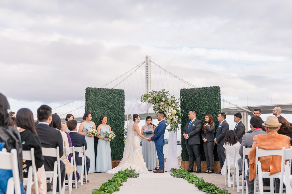 The Winery SF wedding ceremony with Bay Bridge in background