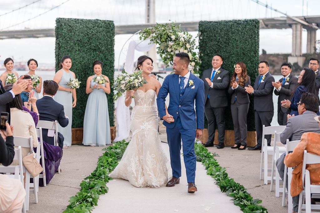 bride and groom ceremony recessional with the Bay Bridge in the background