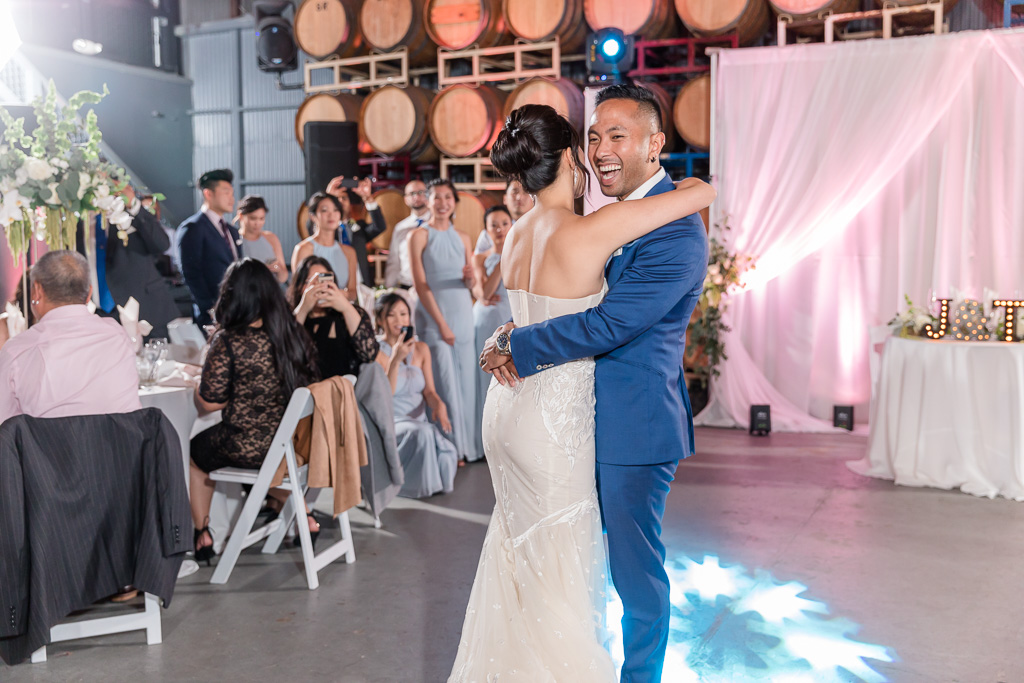 cute photo of bridesmaids taking photos of the bride and grooms first dance