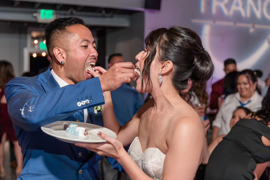 bride and groom peacefully feeding each other cake