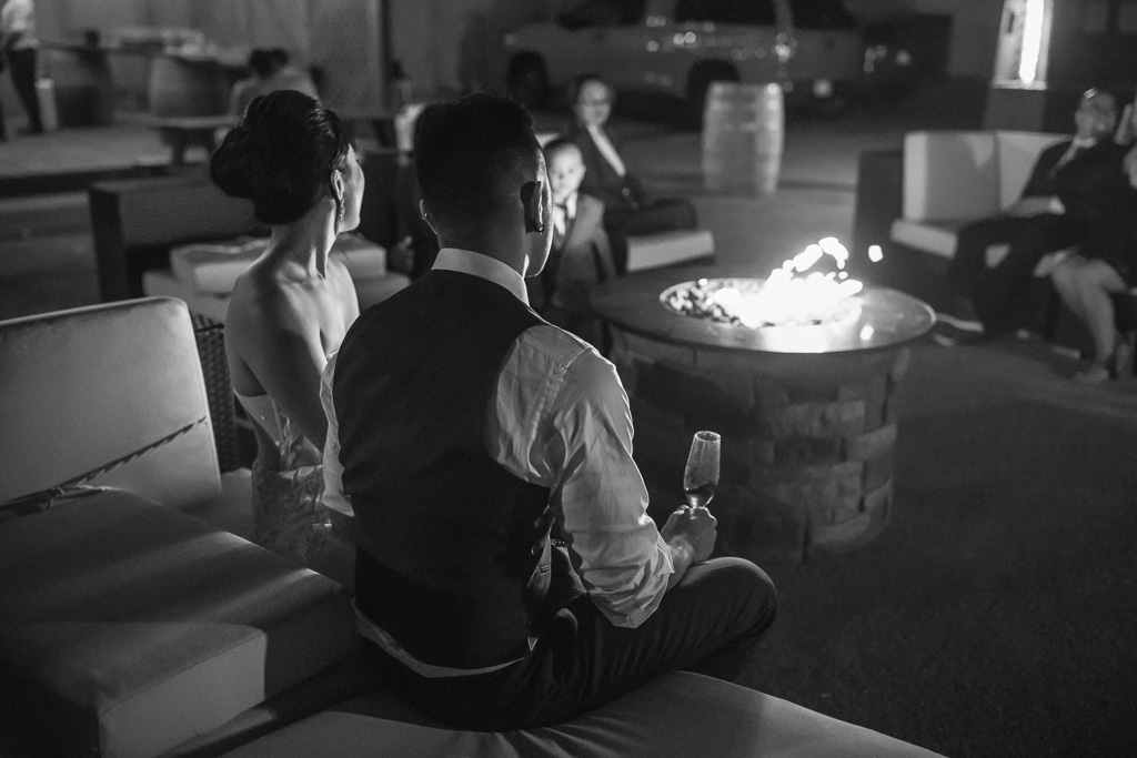 couple enjoying a quiet moment in front of fire pit at night