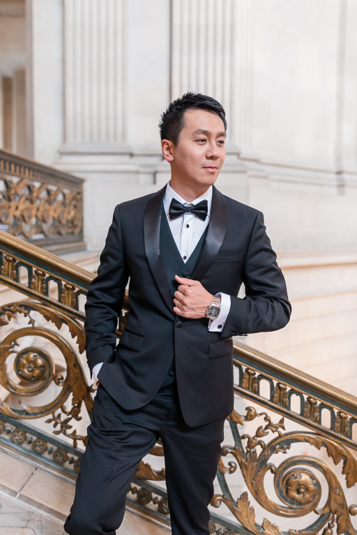 groom portrait by City Hall staircase