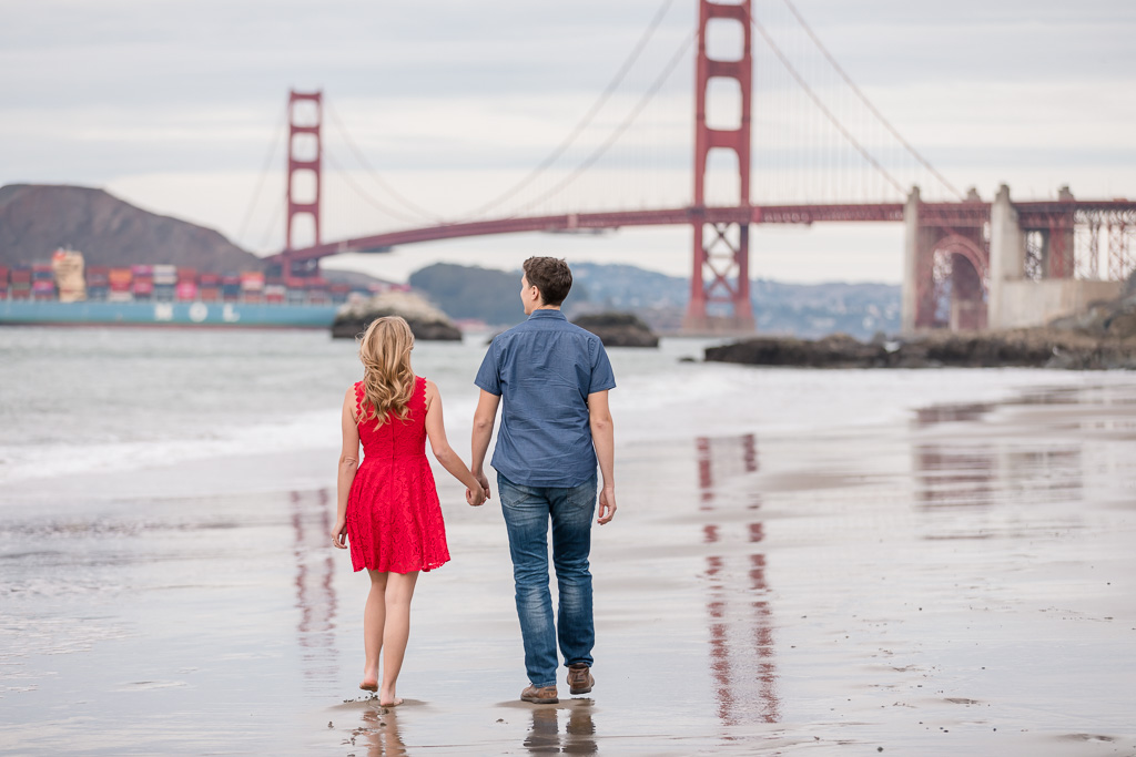 Golden Gate Bridge engagement photo with a colorful cargo ship in the background