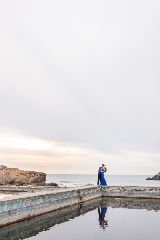 dancing by the water under the dramatic skies - San Francisco engagement photographer