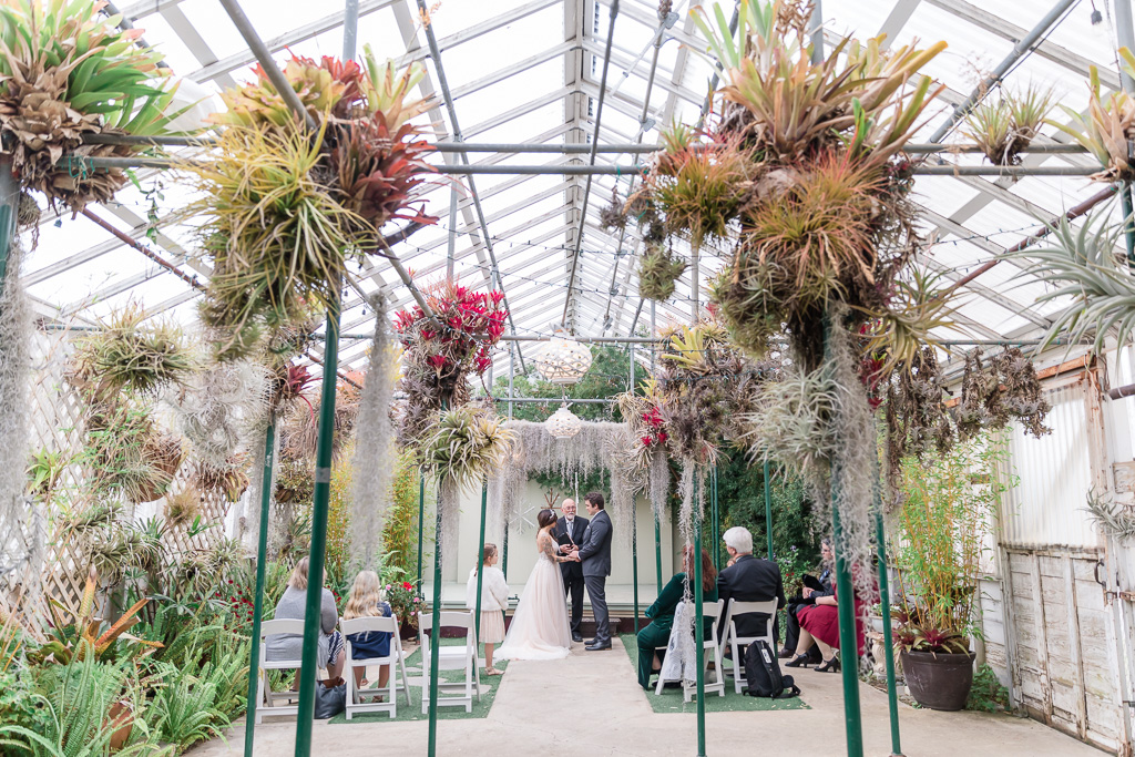 wedding ceremony inside a Pacifica greenhouse
