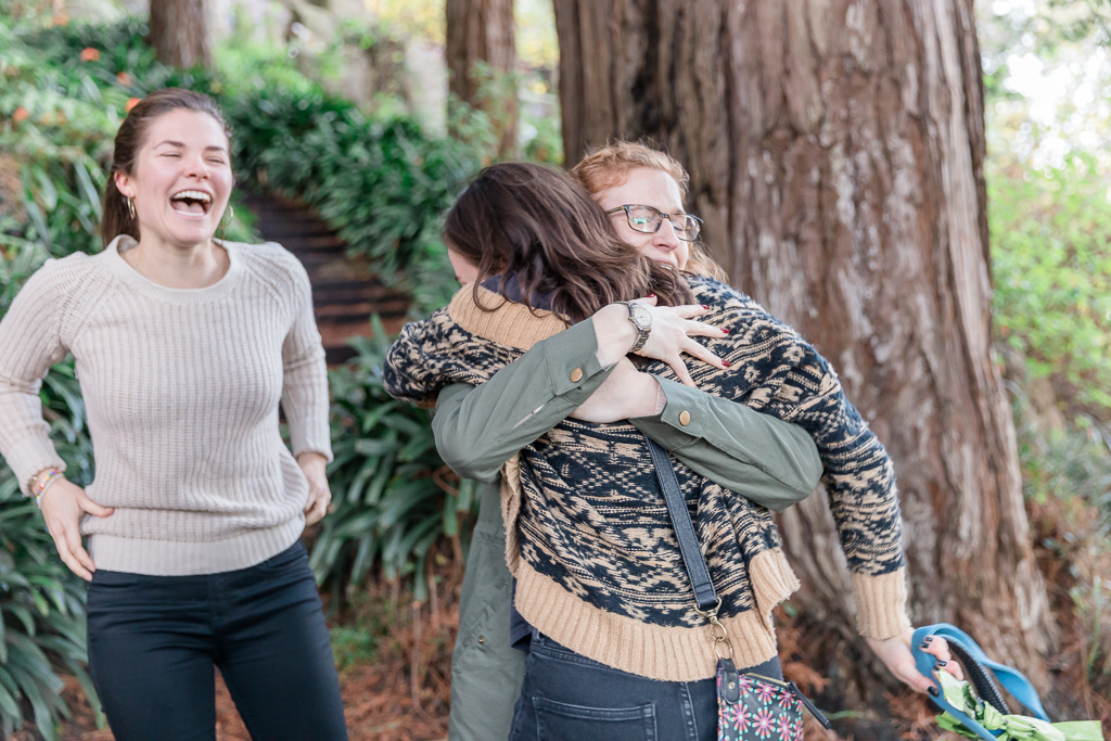 hugging with friends after the proposal