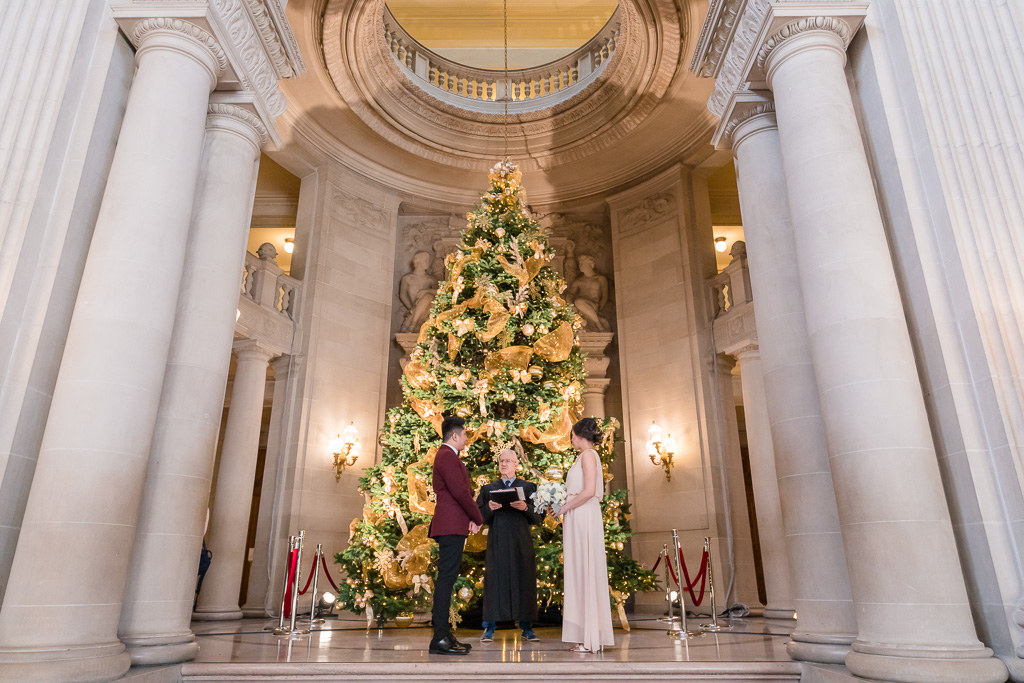 San Francisco city hall wedding ceremony during Christmas holidays