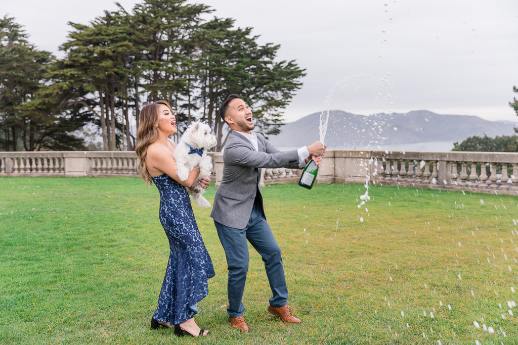 super fun champagne popping engagement photo at Lands End