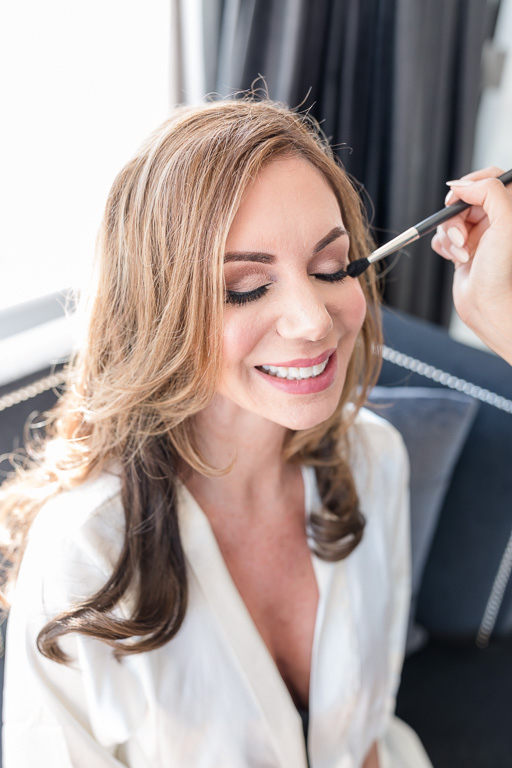 stunning bride getting hair and makeup done at San Francisco Fairmont Hotel