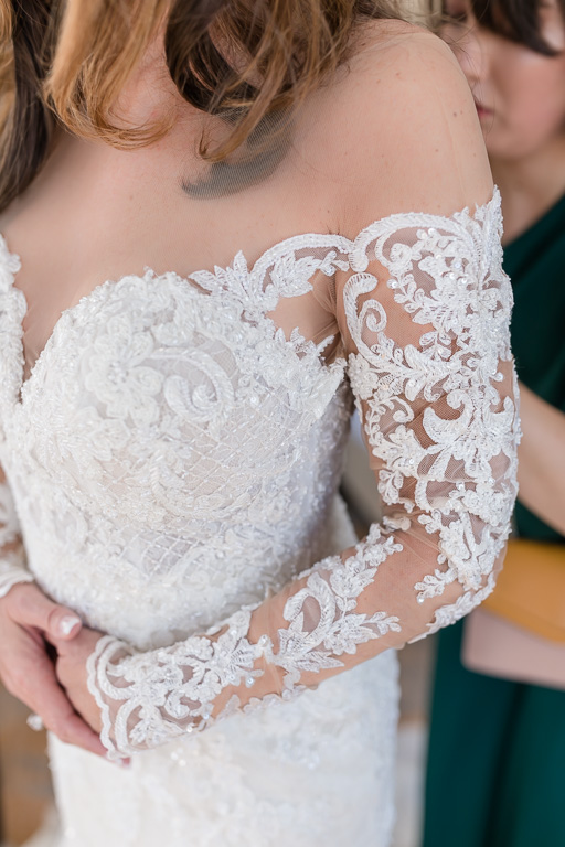 lace details of the illusion neckline of the martina liana wedding gown