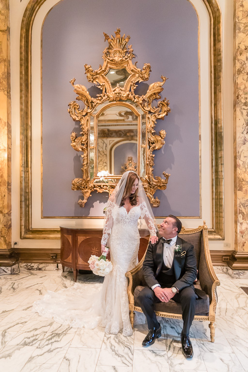bride and groom portrait at the San Francisco Fairmont hotel lobby