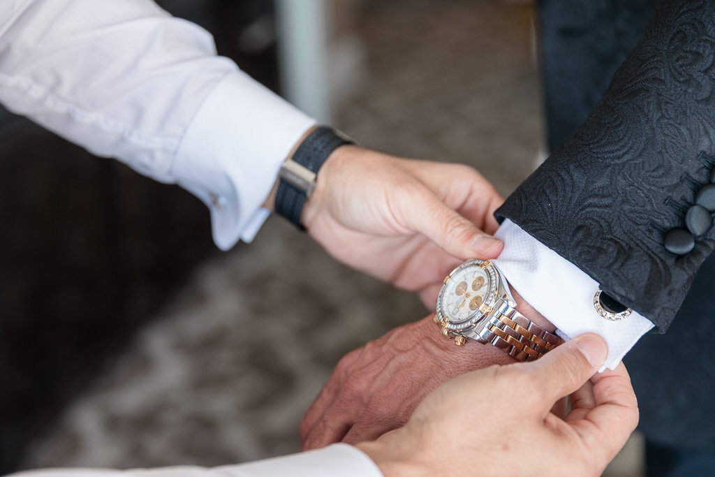 close up photo of the details the groom was wearing