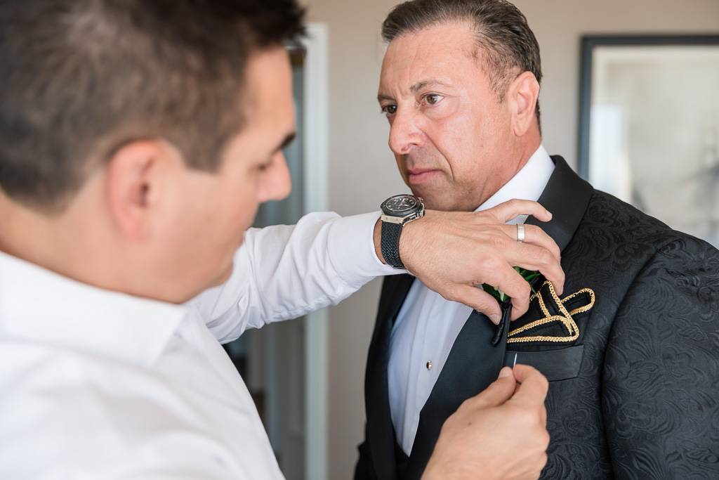 best man fixing the pocket square