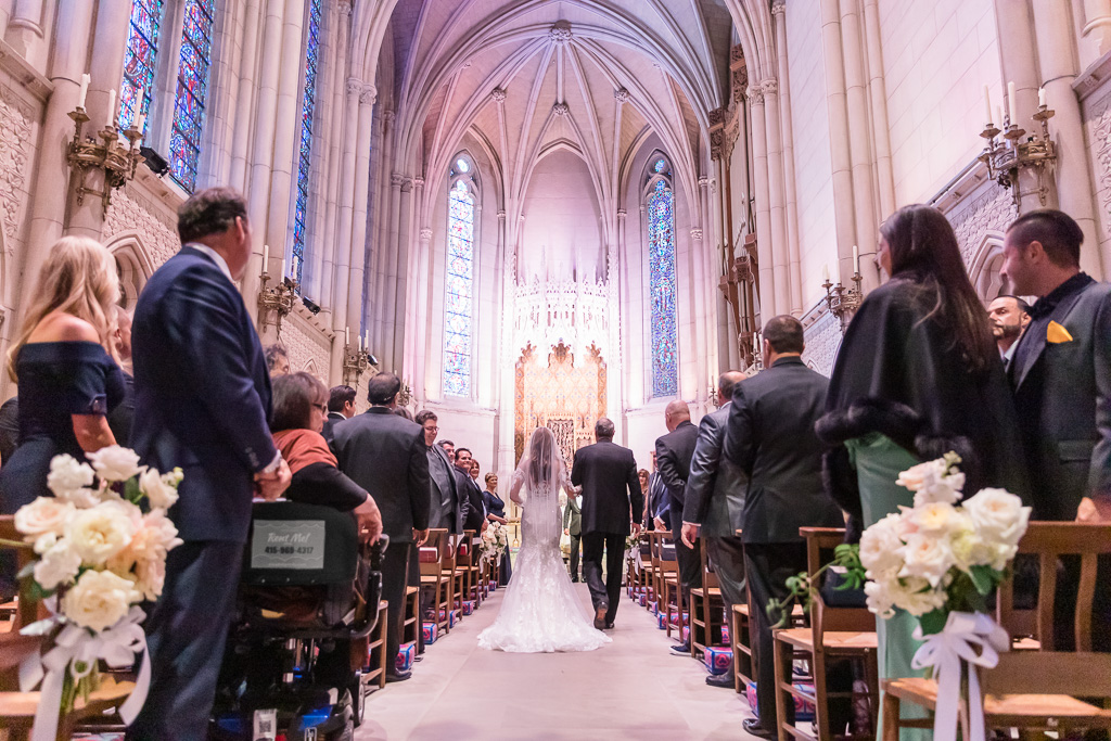bride walks down the aisle at the Grace Cathedral