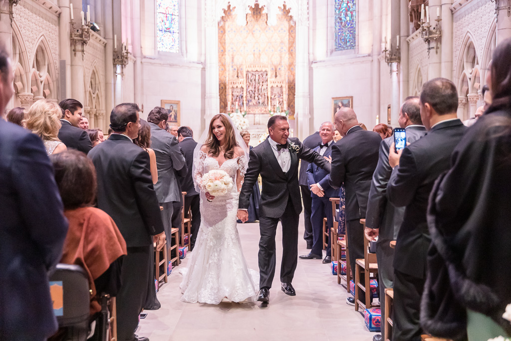walking down the aisle and high-five with their guests