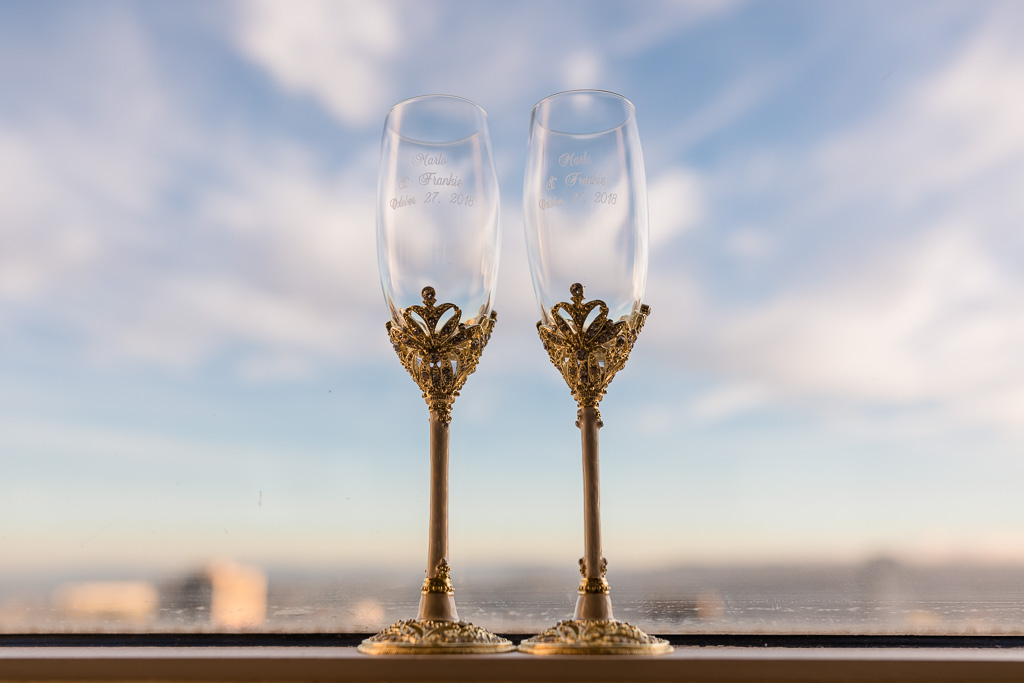 fancy wedding champagne flutes in front of San Francisco city skyline