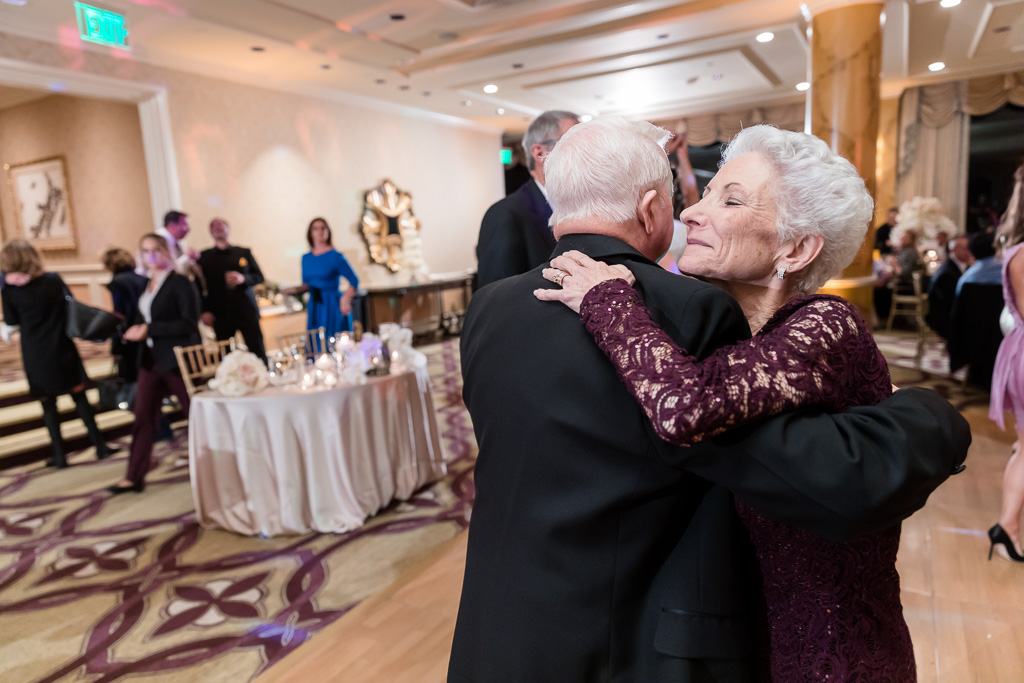 old couple snuggling each other on the dance floor