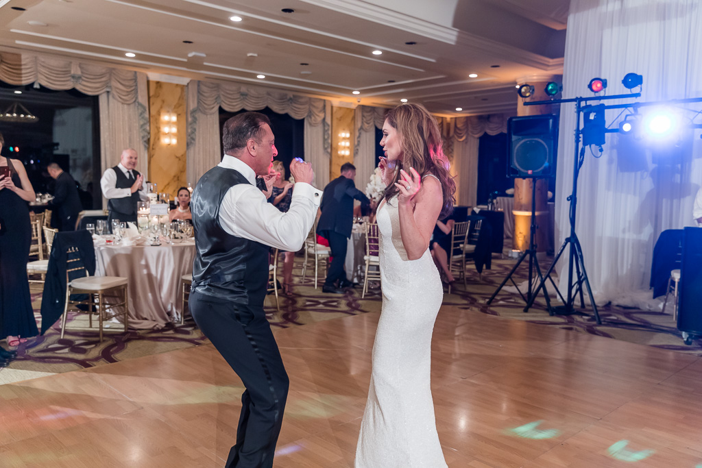 bride and groom dancing with each other