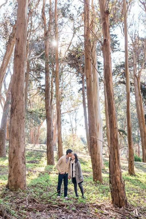 sunny lovers lane engagement photo in the woods