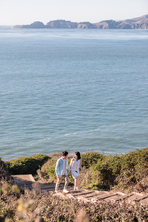 engagement photo on hiking trail by the sea